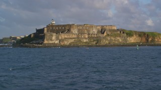 AX104_015 - 5k stock footage aerial video of Fort San Felipe del Morro, Old San Juan, sunset