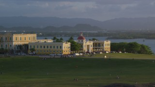 AX104_028 - 5k stock footage aerial video of Escuela De Artes Plasticas De Puerto Rico, sunset