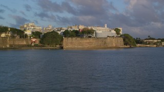 AX104_032 - 5k stock footage aerial video of La Fortaleza, Old San Juan sunset