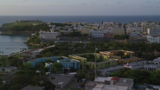 AX104_035 - 5k stock footage aerial video of La Fortaleza and Caribbean buildings, Old San Juan sunset
