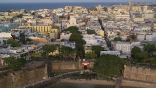 AX104_041 - 5k stock footage aerial video of a Caribbean neighborhood, Old San Juan, Puerto Rico sunset
