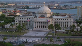 AX104_052 - 5k stock footage aerial video Tilting down on San Juan Capitol Building, Old San Juan, Puerto Rico, sunset