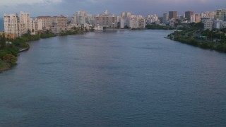 AX104_060 - 5k stock footage aerial video of hotels along Condado Lagoon, San Juan, Puerto Rico sunset