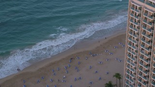 AX104_064 - 5k stock footage aerial video of a Marriott hotel, Caribbean beach and turquoise waters San Juan, Puerto Rico sunset