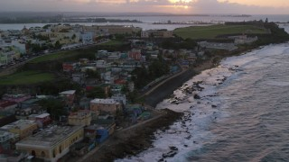 AX104_079 - 5k stock footage aerial video of Cementerio Santa María Magdalena de Pazzis, Old San Juan, Puerto Rico, sunset