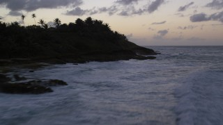 AX104_108 - 5k stock footage aerial video Flying low over blue ocean waters along the coast, Dorado, Puerto Rico, twilight
