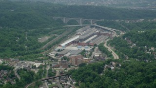 AX105_005 - 5K stock footage aerial video approaching a large factory, Turtle Creek, Pennsylvania