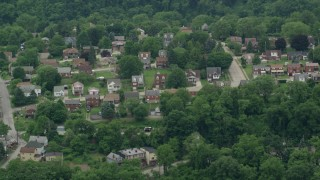 AX105_006 - 5K stock footage aerial video of a suburban neighborhood, Turtle Creek, Pennsylvania