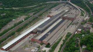 AX105_007 - 5K stock footage aerial video flying over a factory, Turtle Creek, Pennsylvania