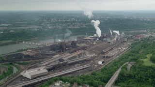 AX105_009 - 5K stock footage aerial video approaching U.S. Steel Mon Valley Works Factory, Braddock, Pennsylvania