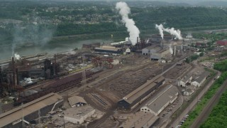 AX105_011 - 5K stock footage aerial video of U.S. Steel Mon Valley Works Factory, Braddock, Pennsylvania
