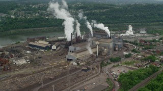 AX105_012 - 5K stock footage aerial video of U.S. Steel Mon Valley Works Factory, Braddock, Pennsylvania