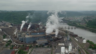 AX105_013 - 5K stock footage aerial video orbiting U.S. Steel Mon Valley Works Factory, Braddock, Pennsylvania