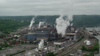 AX105_014 - 5K stock footage aerial video orbiting U.S. Steel Mon Valley Works Factory, Braddock, Pennsylvania