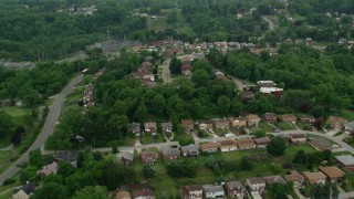 AX105_018 - 5K stock footage aerial video flying over suburban homes, West Mifflin, Pennsylvania