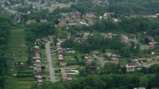 AX105_019 - 5K stock footage aerial video orbiting hilltop suburban homes, West Mifflin, Pennsylvania