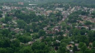 AX105_023 - 5K stock footage aerial video orbiting suburban neighborhood, Munhall, Pennsylvania
