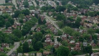 AX105_024 - 5K stock footage aerial video orbiting suburban neighborhood, Munhall, Pennsylvania