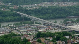 AX105_026 - 5K stock footage aerial video of Homestead Grays Bridge and Shopping Mall, Pittsburgh, Pennsylvania