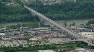 AX105_027 - 5K stock footage aerial video of Homestead Grays Bridge and Shopping Mall, Pittsburgh, Pennsylvania