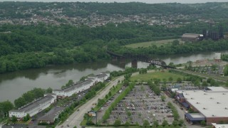 AX105_029 - 5K stock footage aerial video of Railroad Bridge near Factory, Carrie Furnace, Pittsburgh, Pennsylvania