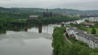 AX105_031 - 5K stock footage aerial video approaching Bridge near Factory, Carrie Furnace, Pittsburgh, Pennsylvania