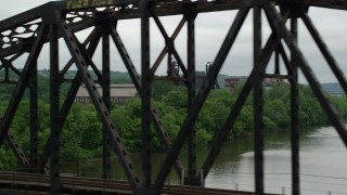 AX105_034 - 5K stock footage aerial video of Railroad Bridge and Factory, Carrie Furnace, Pittsburgh, Pennsylvania