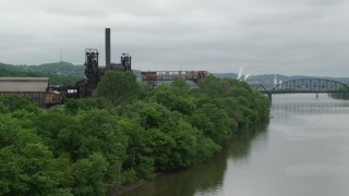 AX105_035 - 5K stock footage aerial video of Waterfront Factory, Carrie Furnace, Pittsburgh, Pennsylvania