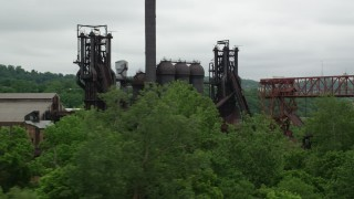 AX105_037 - 5K stock footage aerial video of a historic steel factory, Carrie Furnace, Pittsburgh, Pennsylvania