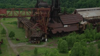 AX105_039 - 5K stock footage aerial video orbiting a steel factory, Carrie Furnace, Pittsburgh, Pennsylvania