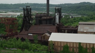 AX105_040 - 5K stock footage aerial video orbiting a steel factory, Carrie Furnace, Pittsburgh, Pennsylvania