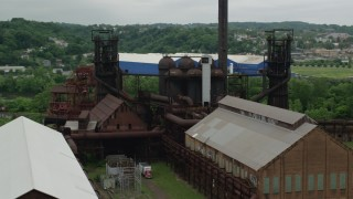 AX105_041 - 5K stock footage aerial video orbiting a steel factory, Carrie Furnace, Pittsburgh, Pennsylvania