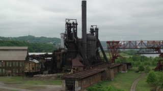 AX105_043 - 5K stock footage aerial video orbiting a steel plant, Carrie Furnace, Pittsburgh, Pennsylvania