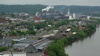 AX105_047 - 5K stock footage aerial video approaching U.S. Steel Mon Valley Works, Braddock, Pennsylvania