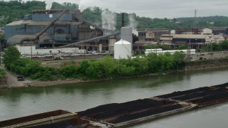 AX105_054 - 5K stock footage aerial video of U.S. Steel Mon Valley Works Factory, Braddock, Pennsylvania