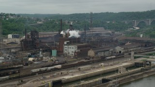 AX105_055 - 5K stock footage aerial video of U.S. Steel Mon Valley Works Factory, Braddock, Pennsylvania