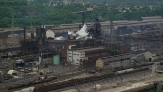 AX105_056 - 5K stock footage aerial video of U.S. Steel Mon Valley Works Factory, Braddock, Pennsylvania