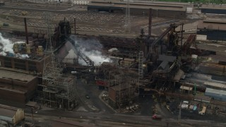 AX105_058 - 5K stock footage aerial video orbiting U.S. Steel Mon Valley Works Factory, Braddock, Pennsylvania