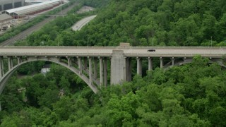 AX105_062 - 5K stock footage aerial video orbiting, tracking light traffic on George Westinghouse Bridge, East East Pittsburgh, Pennsylvania