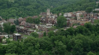 AX105_064 - 5K stock footage aerial video of a Church and Suburban Homes, East Pittsburgh, Pennsylvania