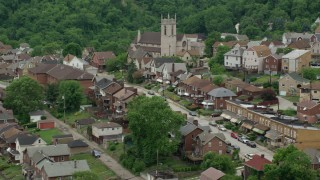 AX105_065 - 5K stock footage aerial video of a church and suburban neighborhood, East Pittsburgh, Pennsylvania