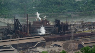 AX105_067 - 5K stock footage aerial video of U.S. Steel Mon Valley Works Factory, Braddock, Pennsylvania