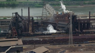AX105_068 - 5K stock footage aerial video of U.S. Steel Mon Valley Works Factory, Braddock, Pennsylvania
