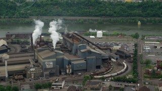 AX105_069 - 5K stock footage aerial video orbiting U.S. Steel Mon Valley Works Factory, Braddock, Pennsylvania