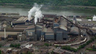 AX105_070 - 5K stock footage aerial video of U.S. Steel Mon Valley Works Factory, Braddock, Pennsylvania
