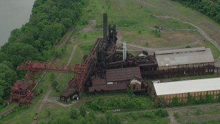 AX105_072 - 5K stock footage aerial video flying over Carrie Furnace Steel Plant, Pittsburgh, Pennsylvania