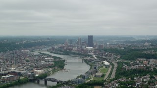 AX105_077 - 5K stock footage aerial video following river to downtown skyscrapers, Downtown Pittsburgh, Pennsylvania