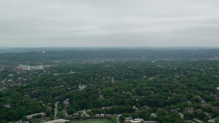 AX105_078 - 5K stock footage aerial video panning right across trees and suburbs, Pittsburgh, Pennsylvania
