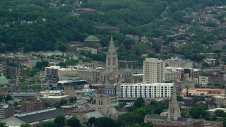 AX105_082 - 5K stock footage aerial video of a church with steeple by apartments, Pittsburgh, Pennsylvania