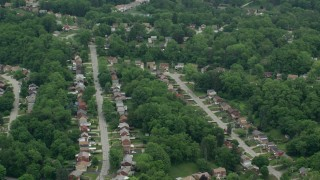 AX105_089 - 5K stock footage aerial video of suburban neighborhoods, Penn Hills, Pennsylvania